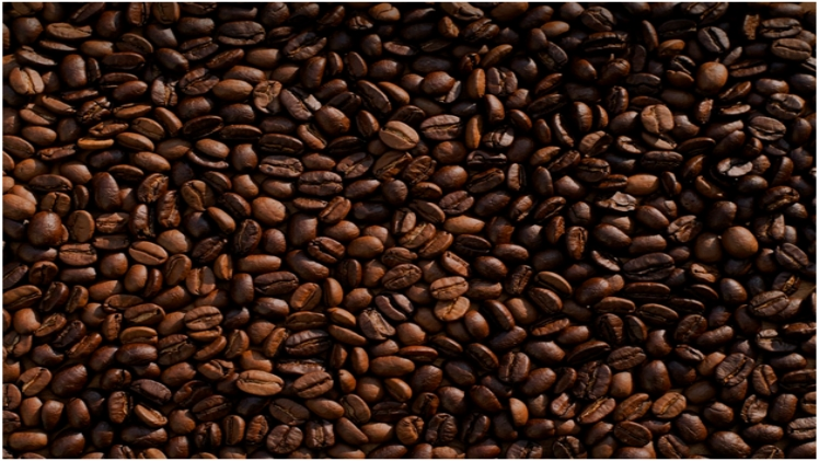 Dark and light coffee beans spread out
